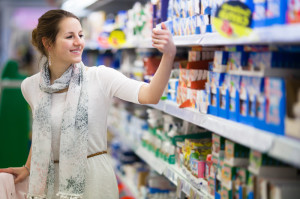 Woman checking labels for her food elimination diet