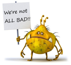 "Human digestive system bacteria cartoon holding a sign saying ""we're not all bad"""