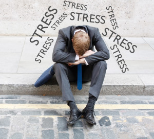 Hunched over man surrounded by stress