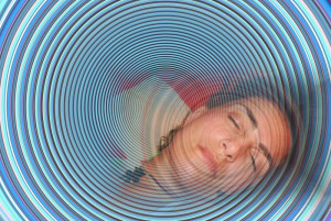 Picture of spirals and a comfortable, hypnotized woman.