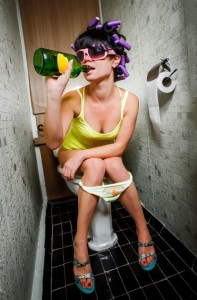 girl sits in a toilet with an alcohol bottle from solvingtheibspuzzle.com