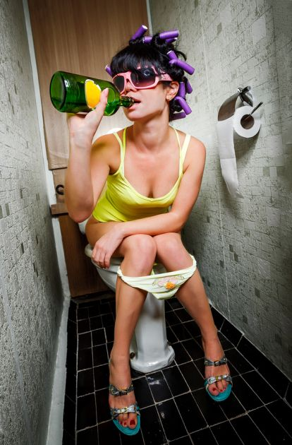 girl sits in a toilet with an alcohol bottle from solvingtheibspuzzle ...