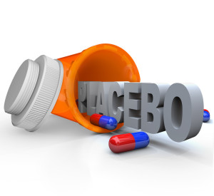 Picture of the word Placebo coming from a medicine bottle.