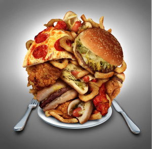 Plate piled high with pizza and fried fatty foods.